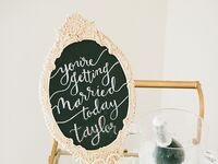 Chalkboard champagne toast sign in the bridal suite
