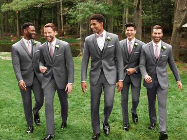 groomsmen walking in matching gray suits
