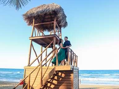 tropical beach engagement photo