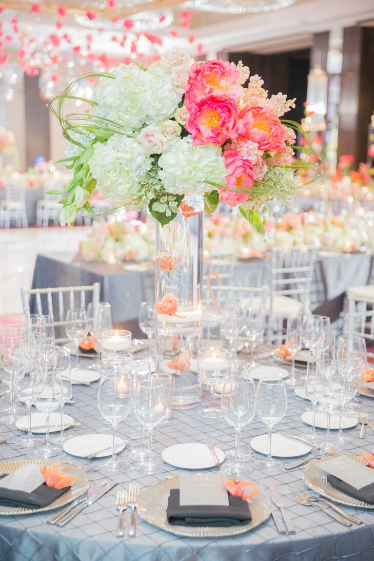 Amber and coral vanda, cymbidium and phaelonopsis orchids were placed throughout the ballroom at the Joule in Dallas, Texas.