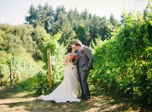 Rebecca and Mark hosted their fall nuptials at the Ponzi Vineyards in Beaverton, OR, surrounded by a lush green expanse of grape vines and mountain vi