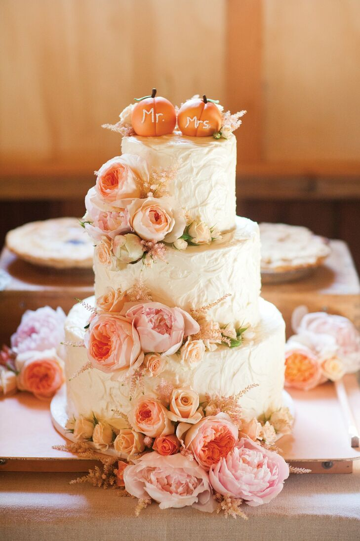 """The stars of the homemade-looking buttercream cake were the fondant """"Mr."""" and """"Mrs."""" peaches that served as a topper."""