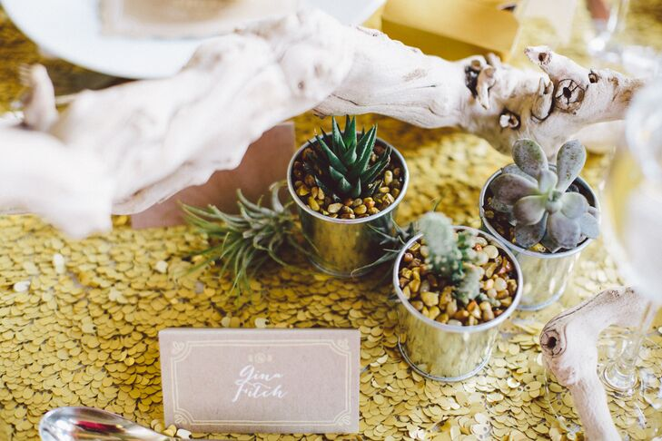 The bride made gold matte sequined table runners for all of the reception tables and used cactuses, succulents and air plants to go along with the Texan and Mexican theme.