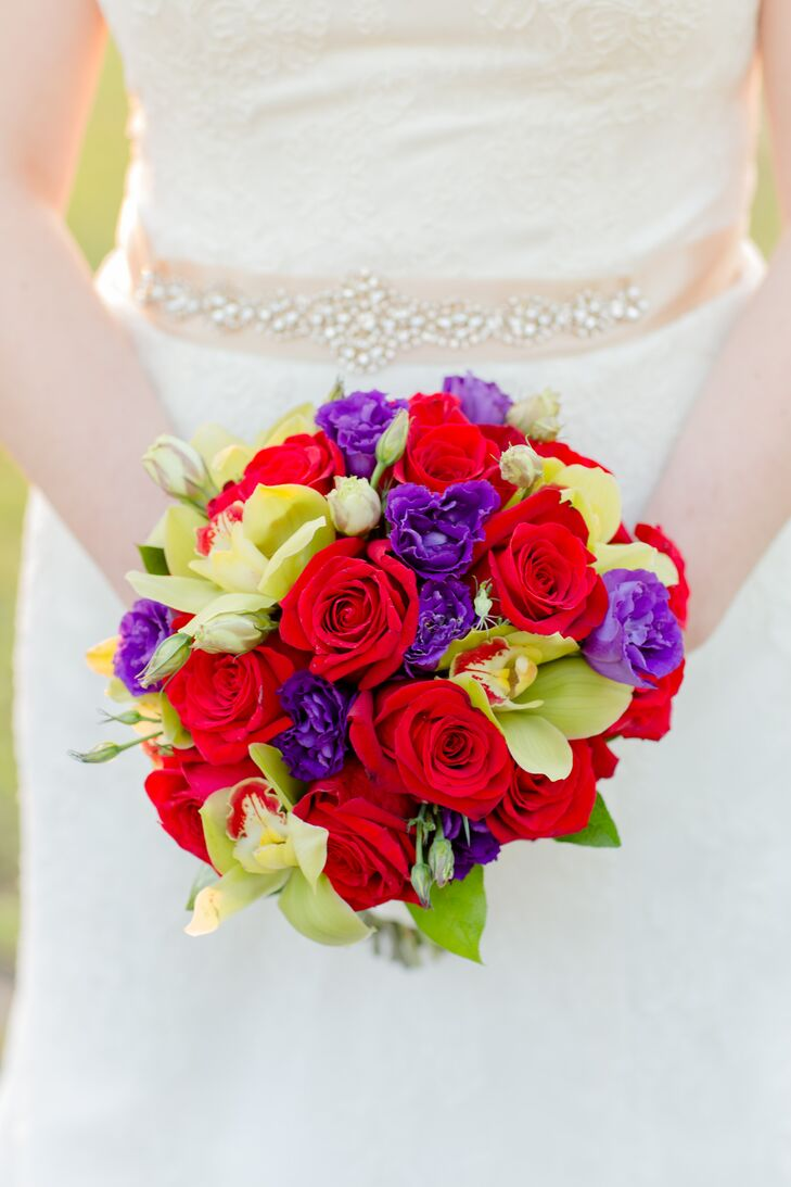 Vibrant red, purple and green blooms, like roses and orchids filled Rachel's bridal bouquet, adding a pop of cheerful color to her look.