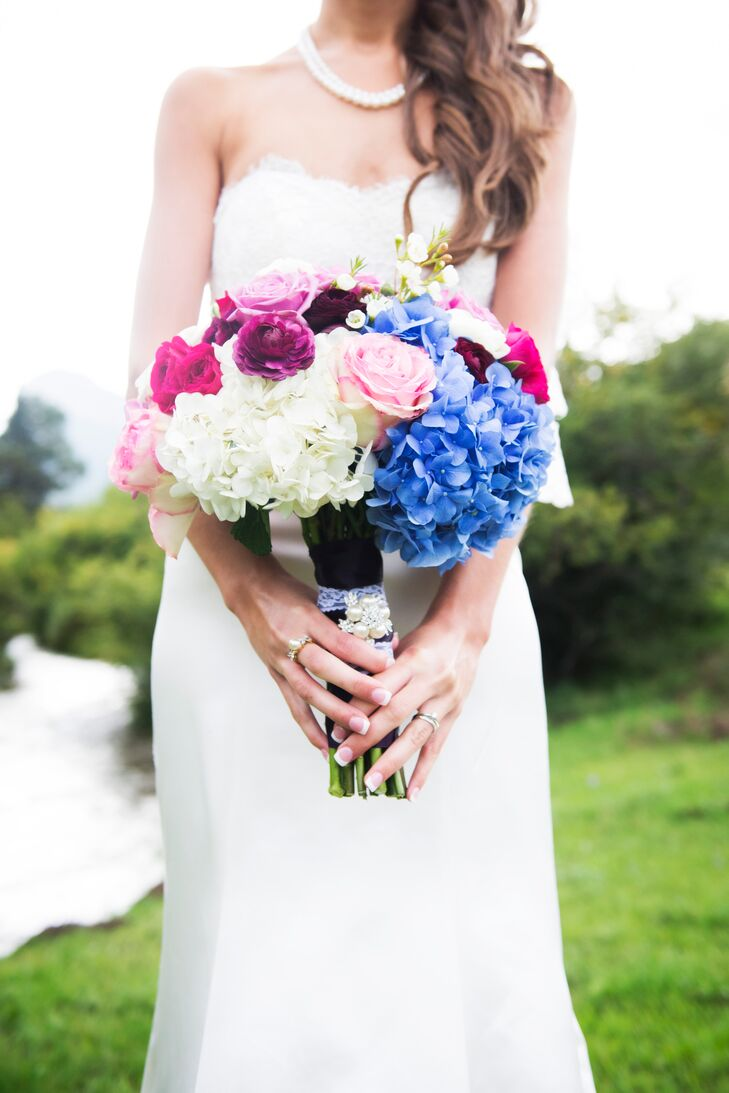 "Megan carried hydrangeas, roses and ranunculuses in shades of blue, pink and purple. ""I really don't know much about flowers, but our florist was willing to take the time to draw several pictures based on my descriptions and took the time to work with me on bringing my vision to reality,"" she says."