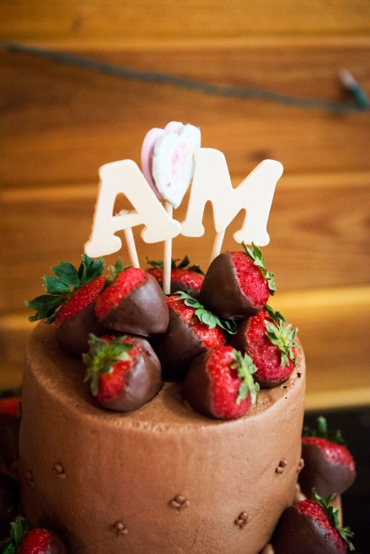 Megan and Adam enjoyed a chocolate wedding cake topped with chocolate-covered strawberries.