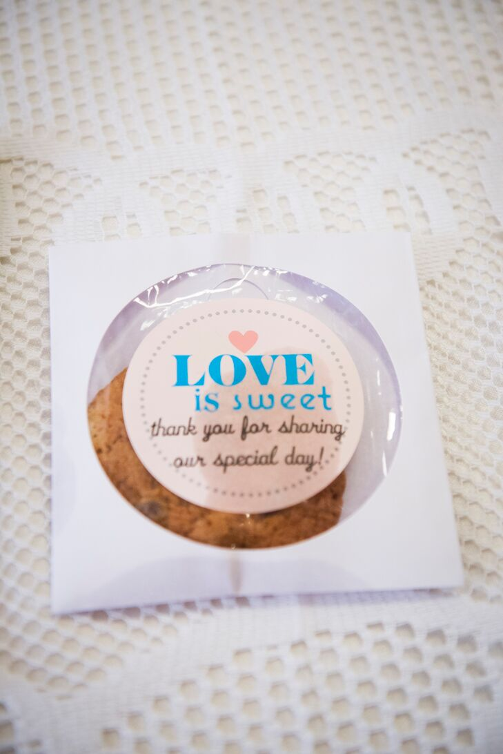 "At the end of the night, each guest received a packaged cookie with the message, ""Love is sweet—thank you for sharing out special day."""