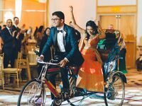 Bride and groom entering wedding reception on bike