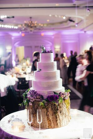 White Wedding Cake on a Wood Slab Cake Stand