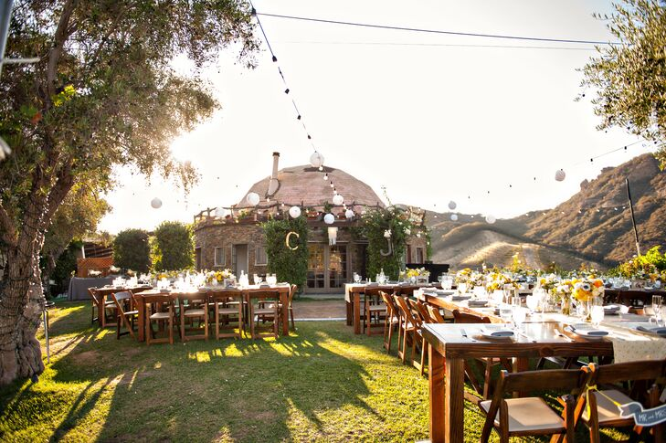 Outdoor Grass Reception with Wood Tables