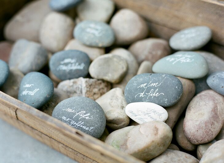 Guests' names were painted onto stones, which were used as escort cards for the reception.