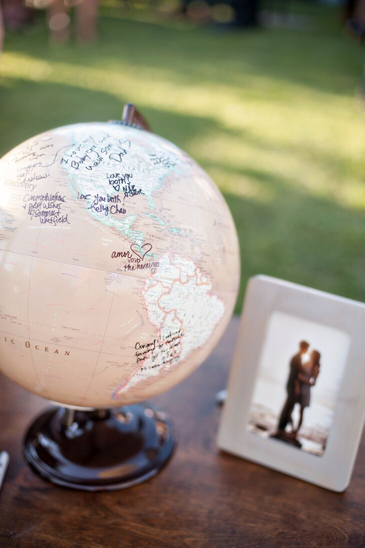 A globe guest book that is now sitting on the couple's bookcase was used to represent the wedding's travel theme.