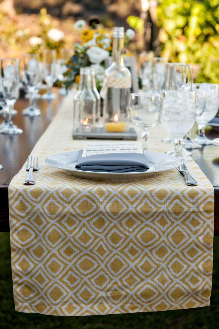 """""""I wanted one fabric that I could use throughout the wedding, so I spent weeks perusing every online fabric store and dragging James to the LA fashion district,"""" Caitlin says. """"Finally I chose one and used it to create all of the table runners (thanks to some help from my mother-in-law), bridesmaid belts, groomsmen pocket squares and as an element of our invitations."""""""