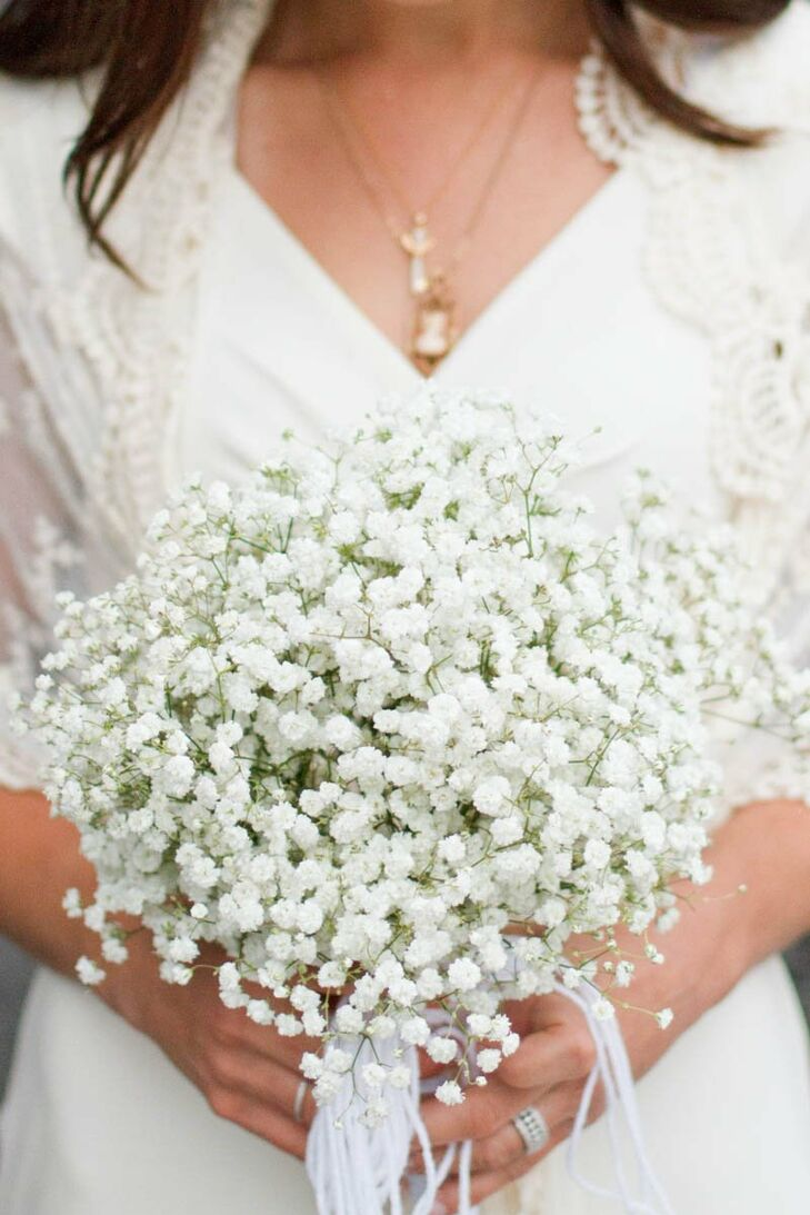 Amy Jo's bridal bouquet was comprised entirely of baby's breath for an ethereal, bohemian vibe that jived perfectly with her lace shawl by BHLDN.