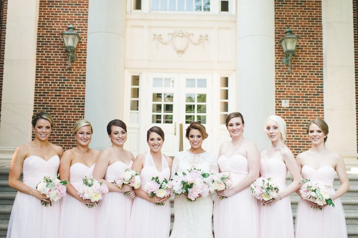 The bridesmaids wore classic, strapless floor-length dresses by Watters in Ice Pink, and Melissa's maid of honor's dress had an illusion halter neckline. All the bridesmaids carried textured bouquets of white and blush peonies that mirrored Melissa's bouquet.