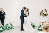 "Paige Saxton-Getty and Hayden Graham relied on a white color palette with pops of greenery for their modern, minimalist wedding at HNYPT. ""The inspira"