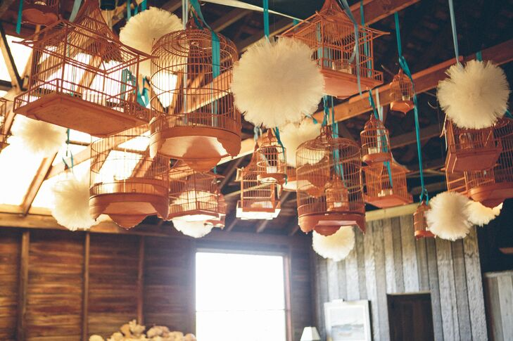 Antique bird cages hung from the ceiling of the cottage, which Aubrey and Andrew accented with tulle poufs.