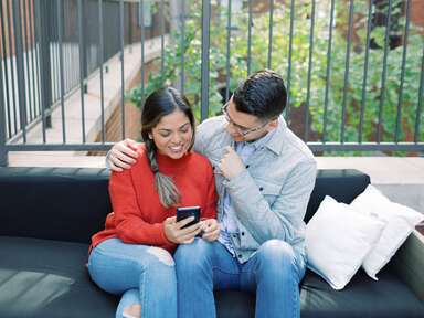 Engaged couple making their wedding registry