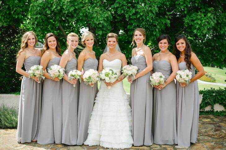 c2dfe3ec292215 The bridesmaids wore long strapless gray dresses with natural ivory and green  bouquets that matched the