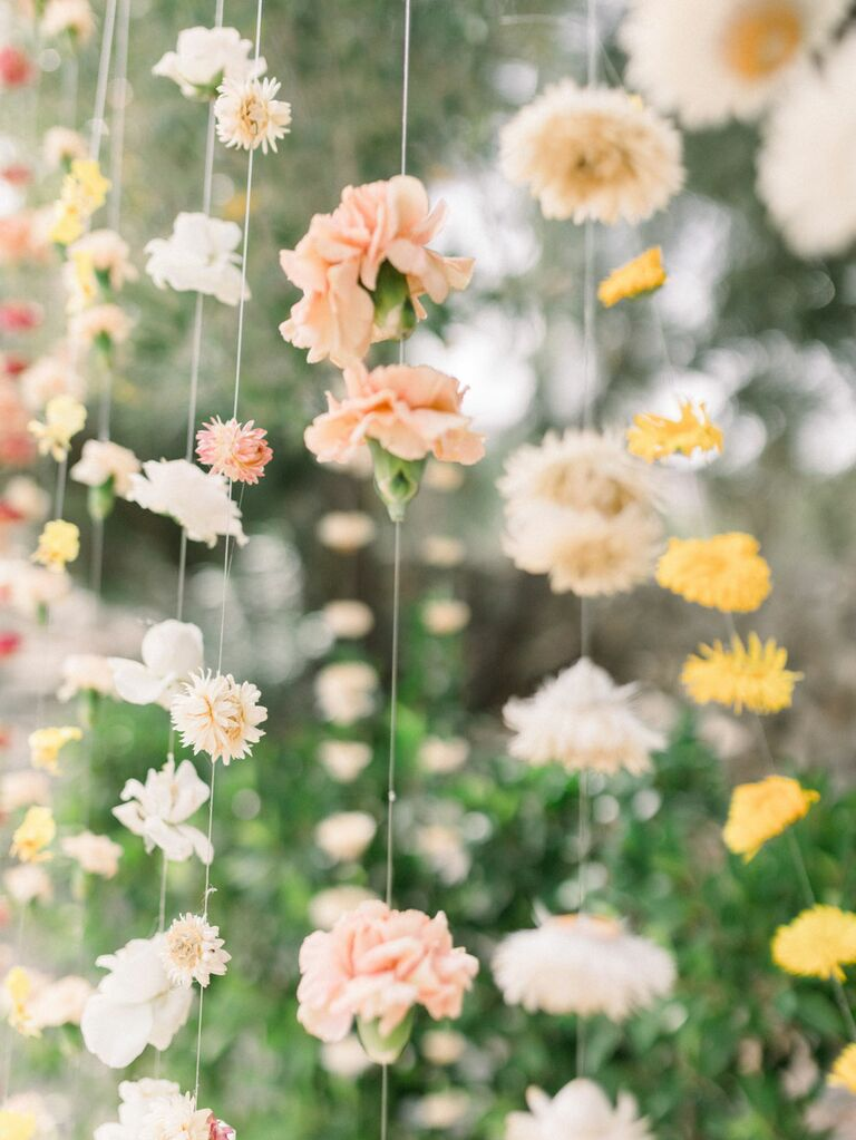 Carnation floral curtain on string at wedding reception