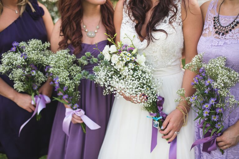 Bridal party bouquets of baby's breath and white freesia