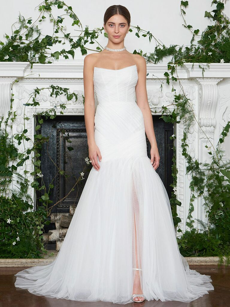 Monique Lhuillier Fall 2018 draped Spanish tulle scoop neck fit and flare wedding dress with high front slit