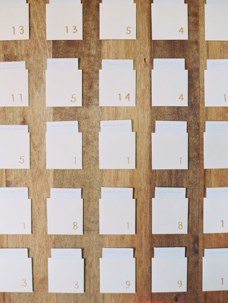 Paper Place Cards on Wood Wall