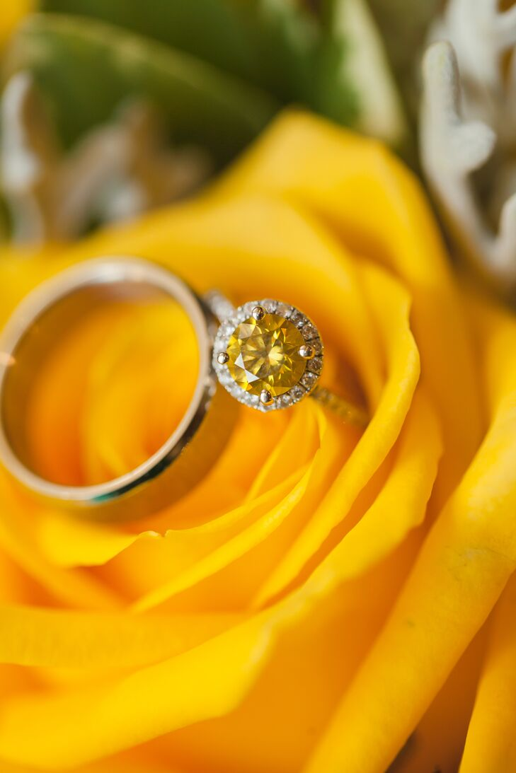 Brenton proposed to Jinitza with a round-cut yellow diamond engagement ring set in a silver band. Jinitza always loved the color yellow, which reminded her of sunshine and happiness.
