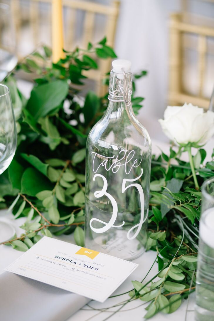 Calligraphed Bottle Table Numbers at Mystical Rose Gardens in Baldwin, Wisconsin