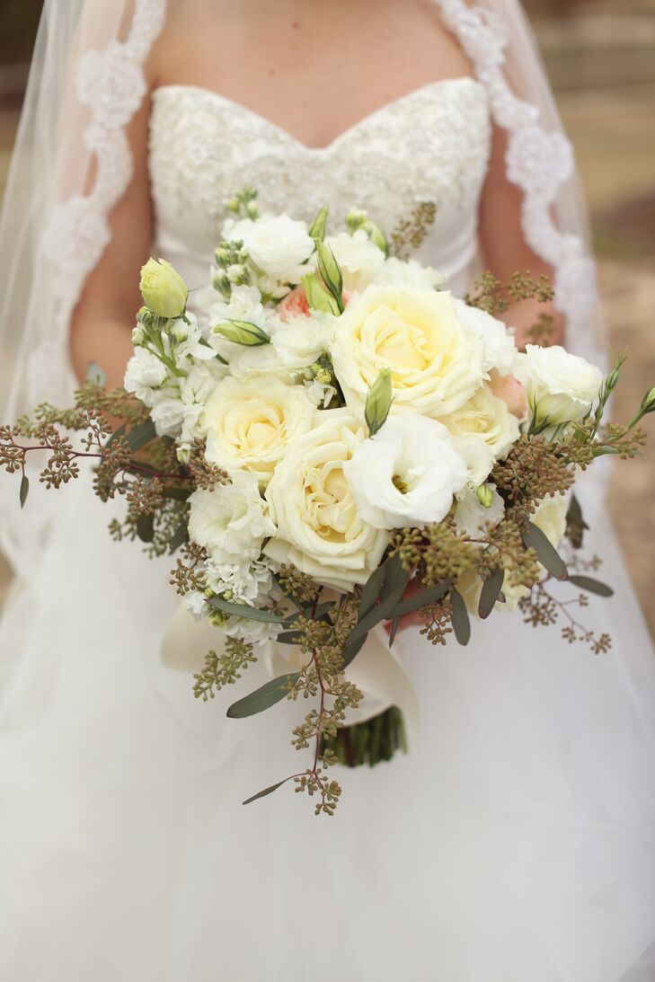 The bride carried a textured cream bouquet of garden roses and wildflowers.