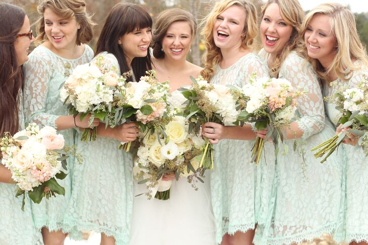 The rustic-chic bridesmaids wore pale mint dresses from Free People.