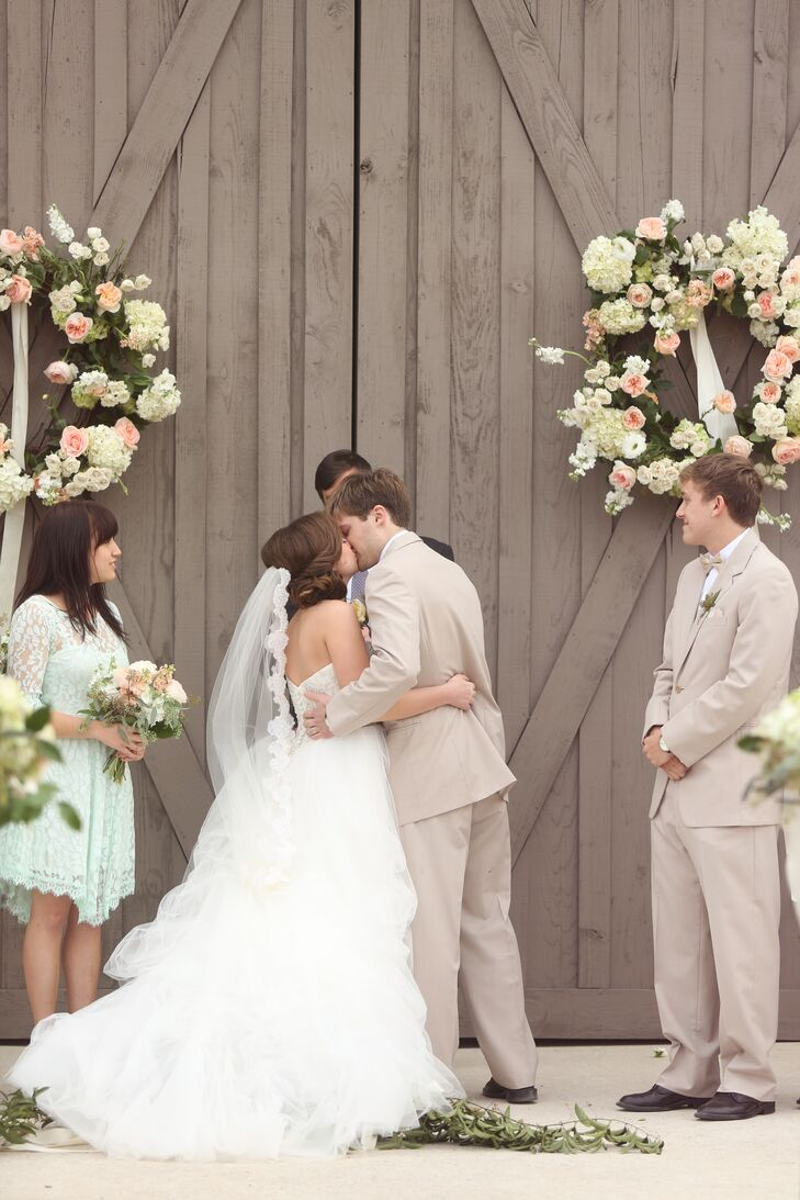 The rustic stable ceremony was decorated with a neutral color palette and mint accents.