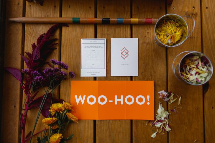 "A bright orange ""Woo-Hoo!"" sign was placed amid the wedding programs at the Spruceton Inn in West Kill, New York."