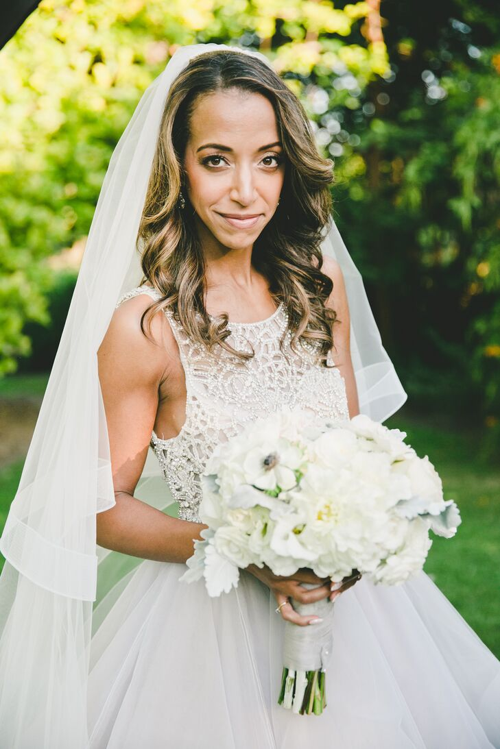 """I was going for a modern fairy-tale look,"" says Esme, who chose a Hayley Paige gown. ""I wanted my dress to be epic without being obnoxious. I wanted to wear something that had a modern spin on the traditional white cake topper. I loved the layers of light gray, ivory, blush and soft lavender horsehair tulle in the skirt."""