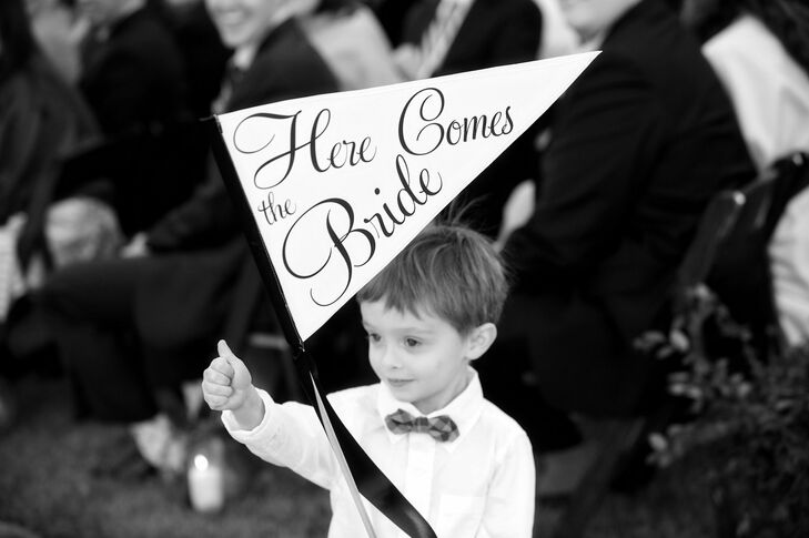 The ring bearer carried a Here Comes the Bride flag down the aisle.