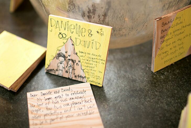 In lieu of a classic guest book, the newlyweds had their guests write their well wishes and advice (or playful illustrations) on painted wooden tiles.