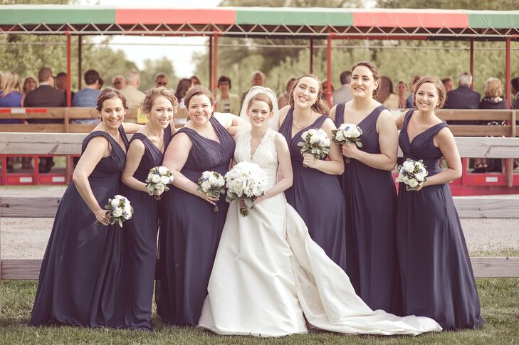 Each of the bridesmaids wore navy, floor-length dresses from Watters.