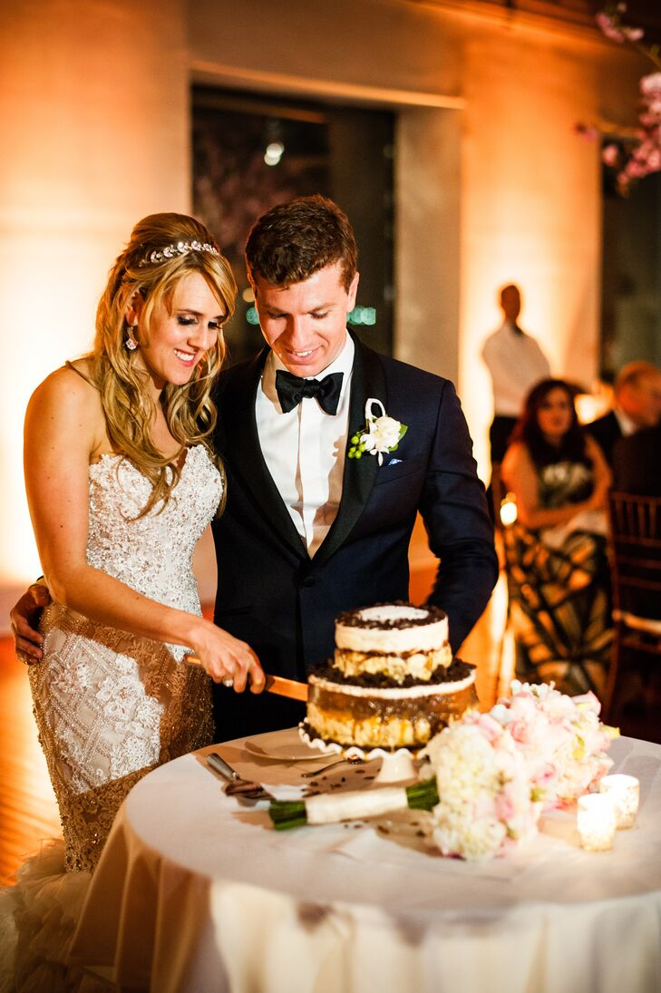"In lieu of classic wedding cake, Hayley and Jared treated guests to a custom ice cream cake. ""We love Ample Hills Creamery in Brooklyn, NY and had them make a customized ice cream cake,"" says Hayley. ""They were a pleasure to work with and the cake was delicious!"" The cake featured four different flavors and the couple chose a naked design to show off the different layers and flavors."