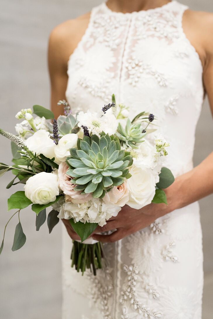 "Marie's bouquet was crafted by Orchid Dynasty and consisted of succulents, eucalyptus, white hydrangeas and garden roses. ""I was so excited to not go with traditional flowers for our wedding,"" Marie says. ""We both love succulents, and I don't think it's because we live in Texas. They are just gorgeous flowers with so much variety. """