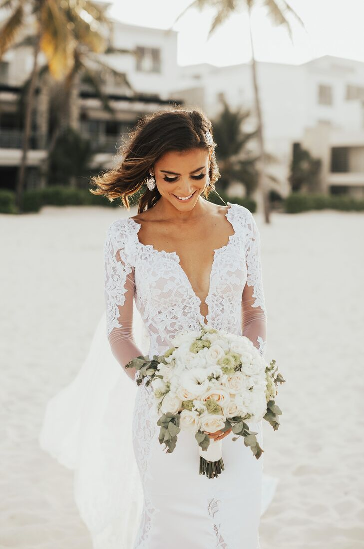 "Angelica carried a bouquet of white roses and greenery. ""Flowers were so important,"" the bride says. ""They really pulled together the whole look."""