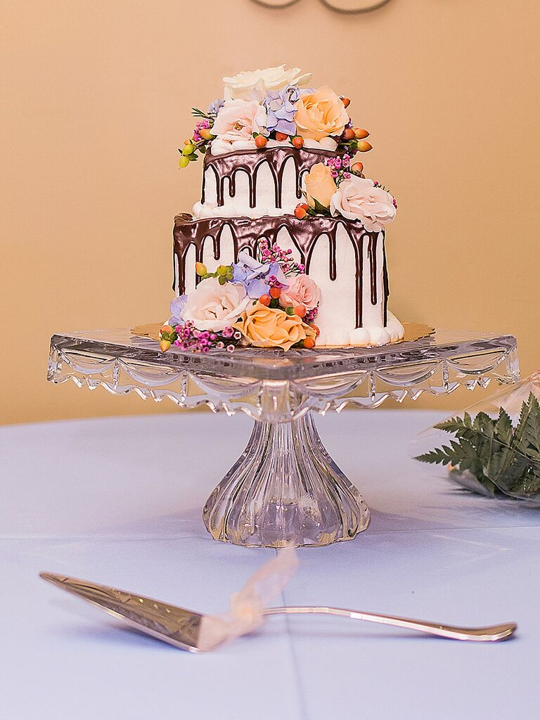 Small wedding cake with flowers and a chocolate drip design