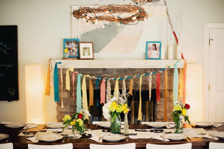 Grapevine wreath chandeliers hung over tables that were set with mismatched china for a casual, homespun feel.