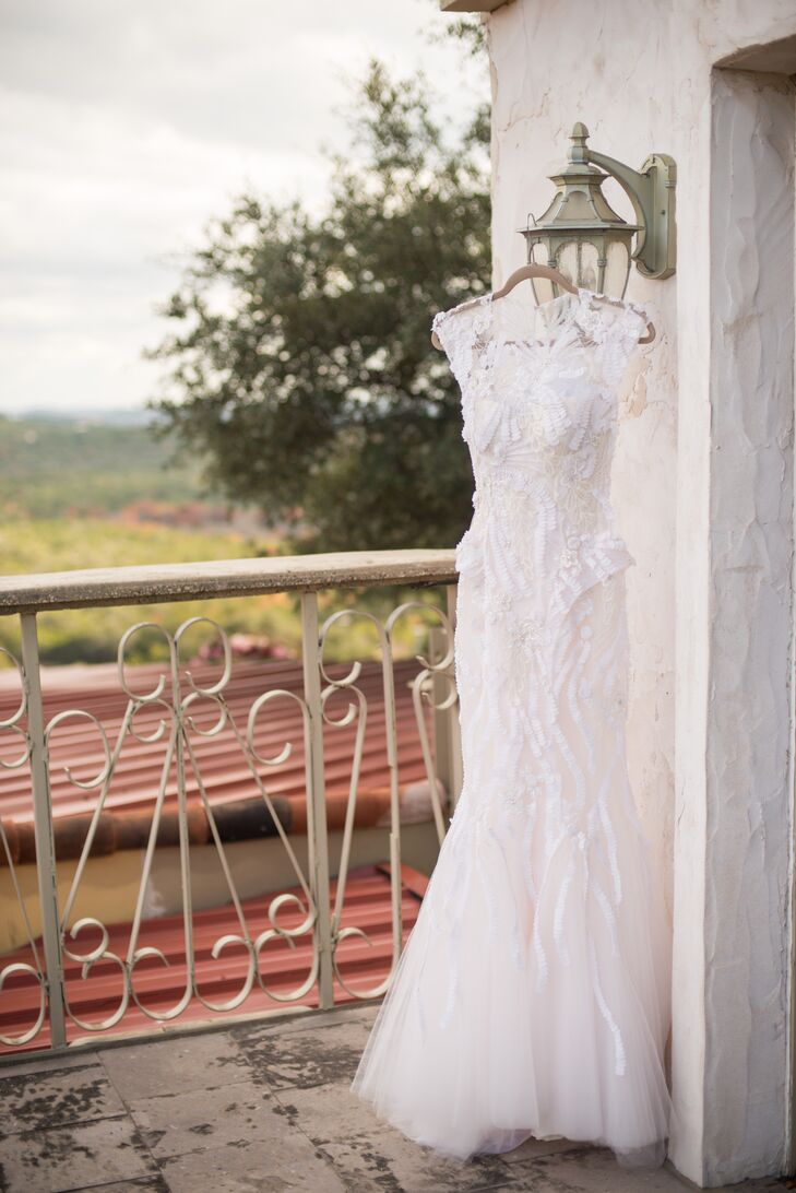 The bride wore a blush tulle Monique Lhullier wedding dress with an illusion neckline and detailed lace appliqué.