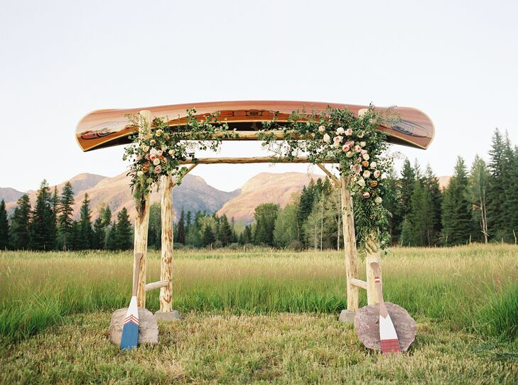 """We were married under a custom arbor of a canoe crafted by one of northern Montana's most well-known canoe builders, Morley Canoes,"" the bride says."