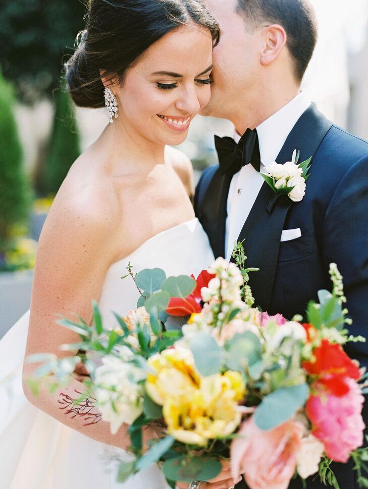 Glamorous Bride with Dangling Diamond Earrings and Formal Groom