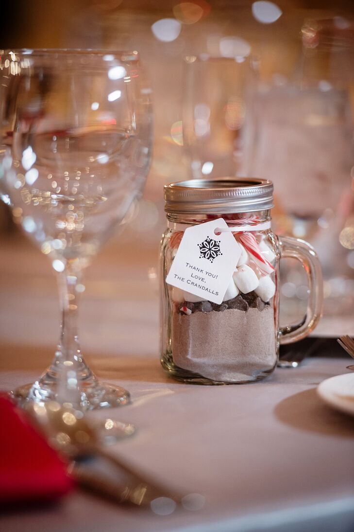 "As a last note of their Christmas theme, James and Francesca sent guests off with mason jars filled with peppermint hot cocoa ingredients. ""We wanted to give our guests something fun and useful that would keep them warm during the winter,"" Francesca says of the DIY favor."