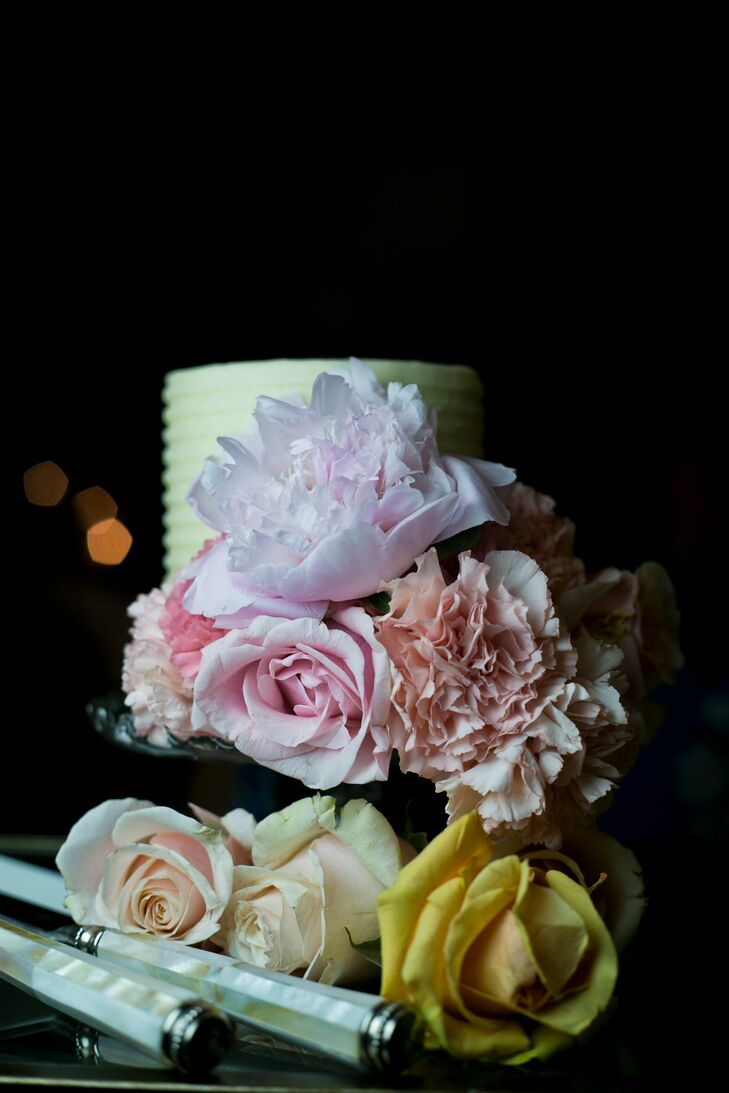"""Aside from a small buttercream cake, guests snacked on salted caramel, chocolate chip cookie dough and lemon-flavored cupcakes. """"We even brought in a hot dog cart from Prairie Dogs for our late night snack!"""" the bride says."""