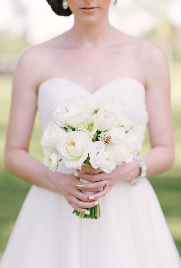 All-white ranunculus and rose bridal bouquet