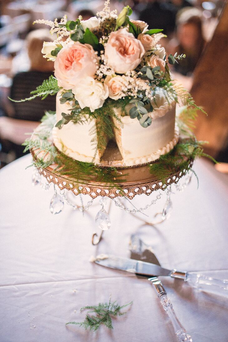 The couple's rustic, yet simple cake was created by K's Bakery in Fargo. Central Market in Detroit Lakes provided extra flowers for decoration while the cake stand came from the bride's personal attendant, Bre.