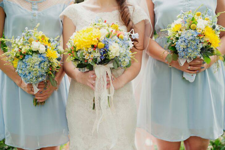 The dominant yellow and blue bouquets had flowers of hydrangeas, roses, craspedia and other blooms and greens making up the arrangement. The bridesmaids held the same bouquet, minus a long white lace ribbon wrapped around the stems of Katy's.